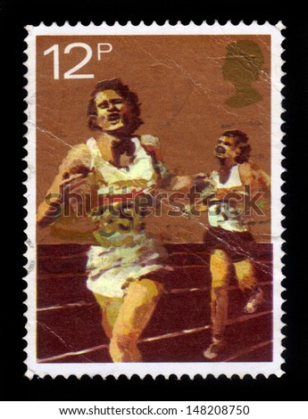UNITED KINGDOM - CIRCA 1980: A stamp printed in United Kingdom shows runners, series sport centenaries, circa 1980 - stock photo