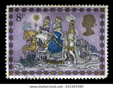 UNITED KINGDOM - CIRCA 1979: A used British Christmas Postage Stamp depicting an illustration of the three Kings following the star, circa 1979. - stock photo
