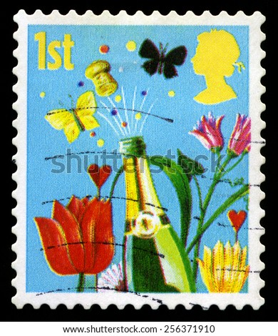 UNITED KINGDOM - CIRCA 2006: A used British postage stamp, depicting a celebratory image, circa 2006. - stock photo