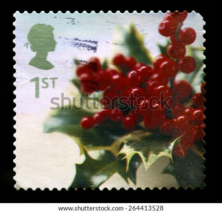 UNITED KINGDOM - CIRCA 2002: A used British Postage Stamp depicting a Christmassy image of Holly, circa 2002. - stock photo