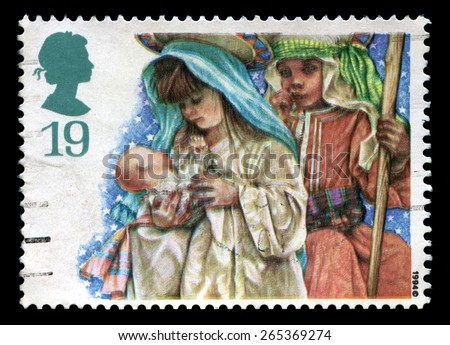 UNITED KINGDOM - CIRCA 1994: A used British Postage Stamp depicting an image of a children's Christmas Nativity, circa 1994. - stock photo