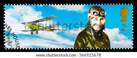 UNITED KINGDOM - CIRCA 2003: A used postage stamp printed in Britain celebrating British Explorers showing Amy Johnson - stock photo