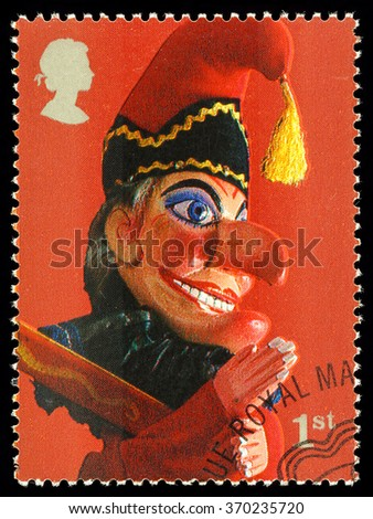 UNITED KINGDOM - CIRCA 2001: A used postage stamp printed in Britain celebrating Traditional Seaside Punch and Judy Show Puppets showing Mr Punch Puppet - stock photo