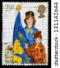 UNITED KINGDOM - CIRCA 1982: A used postage stamp printed in Britain celebrating Youth Organisations showing the Girl Guide Movement, circa 1982 - stock photo