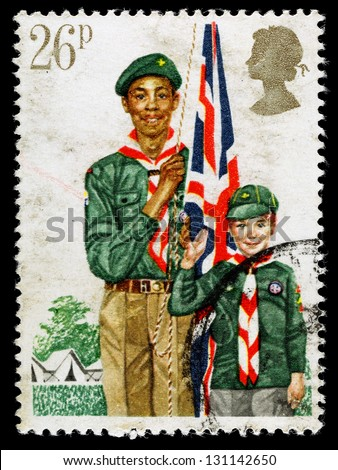 UNITED KINGDOM - CIRCA 1982: A used postage stamp printed in Britain celebrating Youth Organisations showing the Boy Scout Movement, circa 1982 - stock photo
