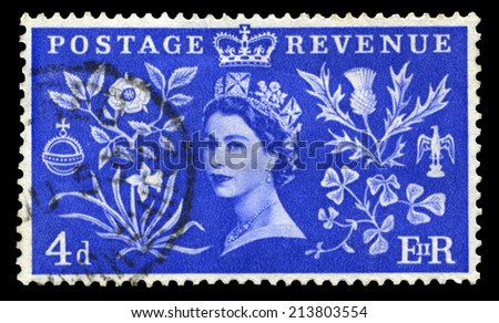 UNITED KINGDOM, CIRCA 1953: A vintage British postage stamp celebrating the Coronation of Queen Elizabeth II and a 'Long Live The Queen' postmark, circa 1953. - stock photo