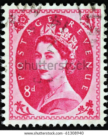 UNITED KINGDOM - CIRCA 1952 to 1965: An English Eight pence Red Used Postage Stamp showing Portrait of Queen Elizabeth 2nd, circa 1952 - 1965 - stock photo