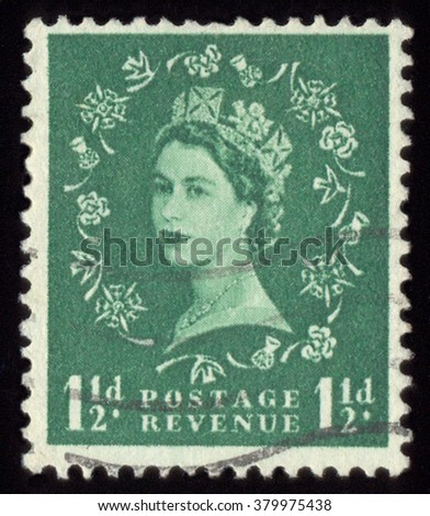 UNITED KINGDOM - CIRCA 1952 to 1965: An English One and half Pence Green Used Postage Stamp showing Portrait of Queen Elizabeth 2nd, circa 1952 to 1965 - stock photo