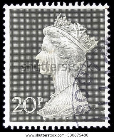 UNITED KINGDOM - CIRCA 1970 to 1972: An English 20p Used Postage Stamp showing Portrait of Queen Elizabeth 2nd, circa 1970