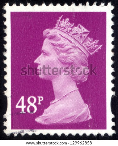 UNITED KINGDOM - CIRCA 1993 to 2007: An English Used Postage Stamp, showing Portrait of Queen Elizabeth 2nd, circa 1993 to 2007. - stock photo