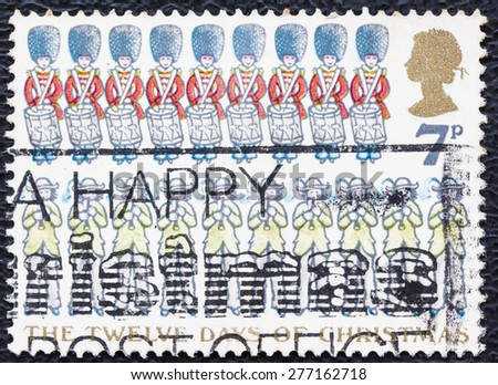 UNITED KINGDOM - CIRCA 1977: Used Christmas Postage Stamp depicting the Carol The Twelve Days of Christmas showing Ten Pipers and Nine Drummers, circa 1977 - stock photo