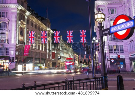 United Kingdom, England, London - 2016 June 17: Popular tourist Picadilly circus with flags union jack in night lights illumination