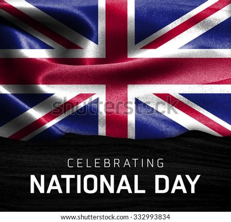 United Kingdom flag and Celebrating National Day Typography on wood background - stock photo