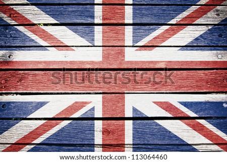united kingdom flag painted on old wood plank background - stock photo