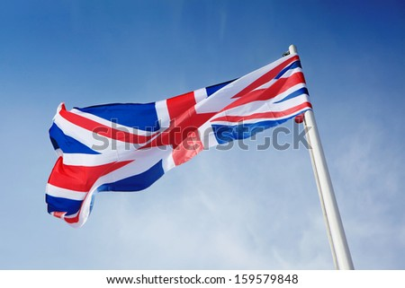 United Kingdom Flag waving on wind. - stock photo