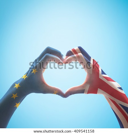 United kingdom great Britain and EU European union flag pattern on person human people hands in heart love shape on blue sky background with clipping path: International labour day concept idea - stock photo