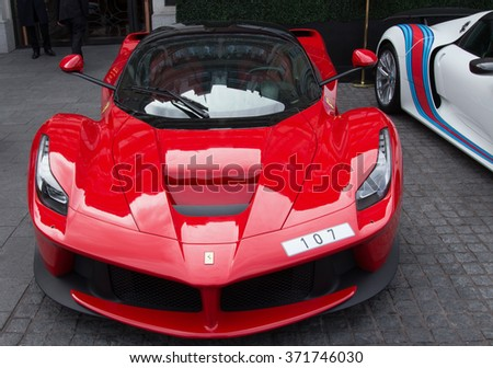 UNITED KINGDOM, LONDON HOTEL THE WELLESLEY - 2015: Luxury supercar ferrari 458 in front of the hotel The Wellesley