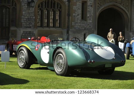 UNITED KINGDOM - SEPTEMBER 13: A classic Aston Martin on display at the United Kingdom Concours d'elegance Classic Car Expo at Windsor Castle on September 13, 2012 in Windsor, United Kingdom. - stock photo