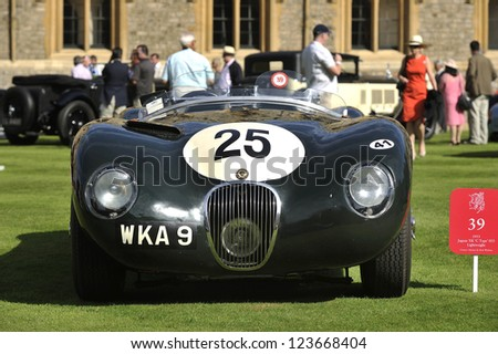 UNITED KINGDOM - SEPTEMBER 13: A classic Jaguar on display at the United Kingdom Concours d'elegance Classic Car Expo at Windsor Castle on September 13, 2012 in Windsor, United Kingdom. - stock photo