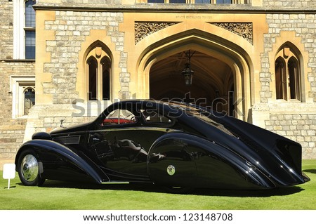 UNITED KINGDOM - SEPTEMBER 13: Aston Martin on display at the United Kingdom Concours d'elegance Classic Car Expo at Windsor Castle on September 13, 2012 in Windsor, United Kingdom. - stock photo