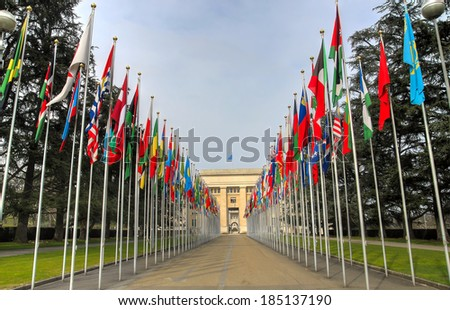 United Nation building entrance with the flags of all nations world wide on both sides in Geneva, Switzerland. - stock photo