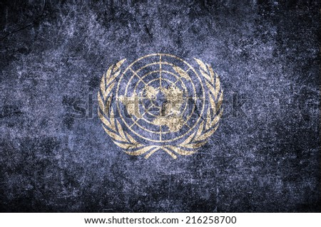 United Nations UN flag on the grunge concrete wall
