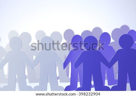 United people paper cut chain as crowd or teamwork abstract concept with white copy space - stock photo