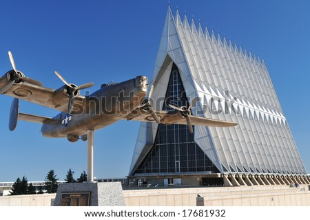United States Air Force Academy Chapel with aircraft sculpture in the foreground - stock photo
