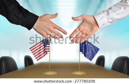 United States and European Union diplomats agreeing on a deal - stock photo