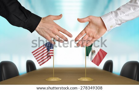 United States and Mexico diplomats agreeing on a deal - stock photo