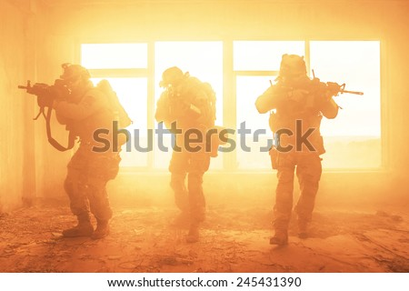 United States Army rangers during the military operation in the smoke and fire - stock photo