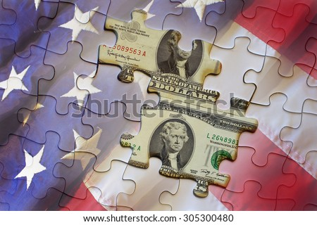 United States bank note and Federal Reserve note on american flag puzzle - stock photo
