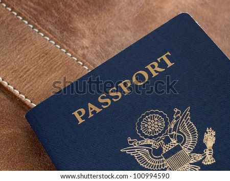 United States blue passport on leather backdrop. - stock photo