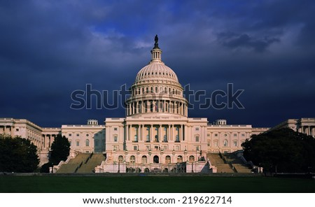 United States Capitol building against an ominous sky. - stock photo
