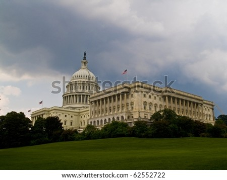 United States Capitol Building on cloudy day - stock photo