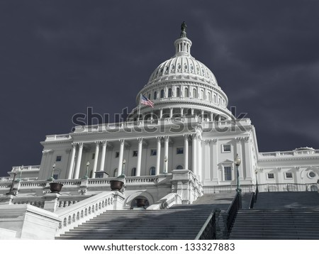 United States Capitol building with stormy weather.