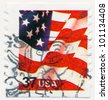 UNITED STATES - CIRCA 2002: A postage stamp printed in the United States, features waving US flag, circa 2002 - stock photo
