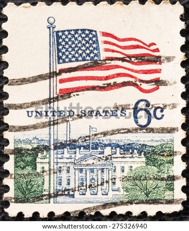 UNITED STATES - CIRCA 1968: A postage stamp printed in the United States, features waving US flag, circa 1968 - stock photo