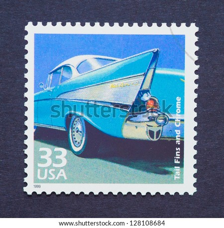 UNITED STATES � CIRCA 1999: a postage stamp printed in USA showing a detail of a blue cadillac car, circa 1999. - stock photo