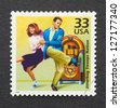 UNITED STATES - CIRCA 1999: A postage stamp printed in USA showing an image of a couple dancing jitterbug, circa 1999. - stock