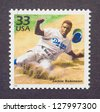 UNITED STATES � CIRCA 1999: a postage stamp printed in USA showing an image of Jackie Robinson, circa 1999. - stock photo