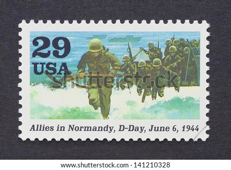 UNITED STATES - CIRCA 1995: a postage stamp printed in USA showing an image of the D-Day Invasion of Normandy in the Second World War, circa 1995. - stock photo