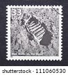 UNITED STATES - CIRCA 1999: A postage stamp printed in USA showing an image of the first step on the moon made by Neil Armstrong, circa 1999. - stock photo