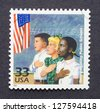 UNITED STATES -Â?Â? CIRCA 1999: A postage stamp printed in USA showing an image of the integration on the public school system in the fifties, circa 1999. - stock photo
