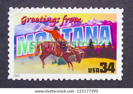 UNITED STATES - CIRCA 2002: a postage stamp printed in USA showing an image of the Montana state, circa 2002. - stock photo