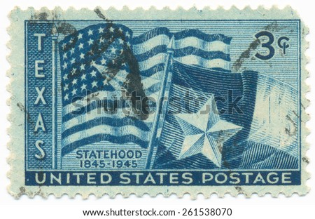 UNITED STATES - CIRCA 1945: A stamp printed in the United States, shows the U.S. and Texas State Flags, circa 1945 - stock photo