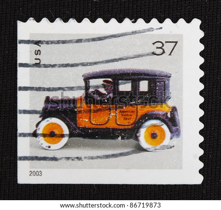 UNITED STATES - CIRCA 2003: A stamp printed in United States shows Antique car, circa 2003