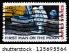 UNITED STATES - CIRCA 1969: A stamp printed in USA shows Neil Armstrong, first step on the moon, circa 1969 - stock photo