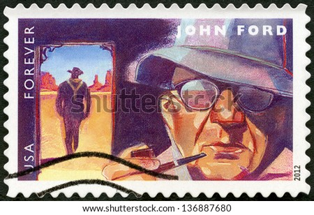 UNITED STATES - CIRCA 2012: A stamp printed in USA shows portrait of John Ford (1894-1973), scene from The Searchers, circa 2012 - stock photo
