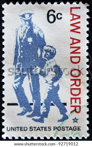 UNITED STATES - CIRCA 1968: A stamp printed in USA shows The police as protector and friend and respect for law and order, circa 1968 - stock photo